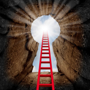 54085833 - reaching success as a business opportunity and career advancement concept as a red ladder leading to an opening in a mountain cliff looking up shaped as a key hole with the sun shinning down.
